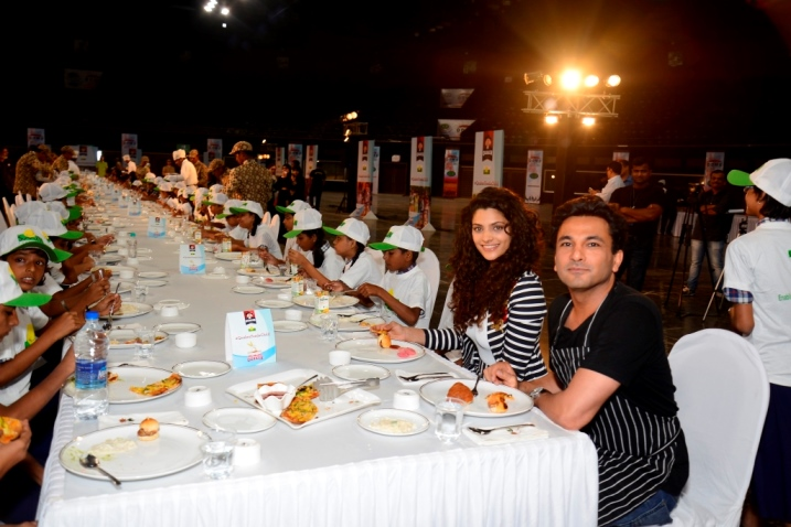 Nutrition Brand Ambassador Chef Vikas Khanna & actress Saiyami Kher sharing a meal with the children from Smile Foundation at the launch of Quaker Feed a Child initiative on World Food Day